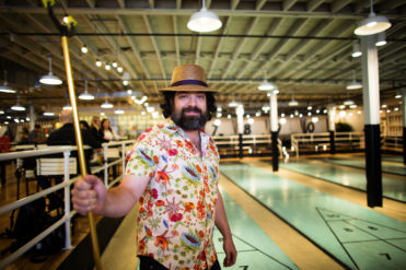 BROOKLYN, NY: Owner Jonathan Schnapp plays shuffleboard on league night at the Royal Palms Shuffleboard Club in Brooklyn, NY. (Photo by: Shaul Schwarz)